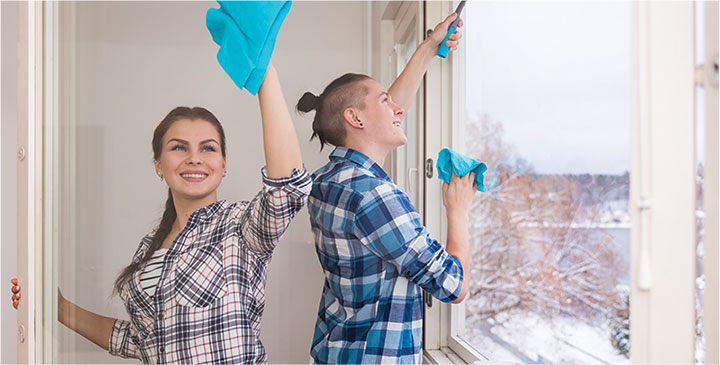 photo of two happy cleaners doing work